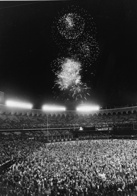 Fans pour onto the field at Busch Stadium at the conclusion of the World Series as fireworks blast overhead, St. Louis, Missouri, October 20, 1982. St. Louis defeated Milwaukee 6 -3 in Game Seven to win the series. (Photo by Layne Murdoch/BBS/Getty Images