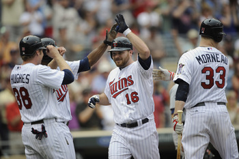 MINNEAPOLIS, MN - MAY 11: Luke Hughes #38, Denard Span #2, Jason Kubel #16 and Justin Morneau #33 of the Minnesota Twins celebrate a three-run home run by Kubel off Daniel Schlereth #55 of the Detroit Tigers during in the seventh inning of their game on M