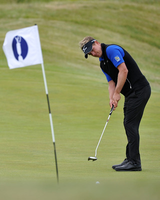 SANDWICH, ENGLAND - JULY 12:  Luke Donald of England putts during the second practice round during The Open Championship at Royal St. George's on July 12, 2011 in Sandwich, England. The 140th Open begins on July 14, 2011.  (Photo by Stuart Franklin/Getty
