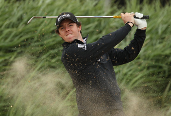 SANDWICH, ENGLAND - JULY 12:  Rory McIlroy of Northern Ireland hits a bunker shot during the second practice round during The Open Championship at Royal St. George's on July 12, 2011 in Sandwich, England. The 140th Open begins on July 14, 2011.  (Photo by