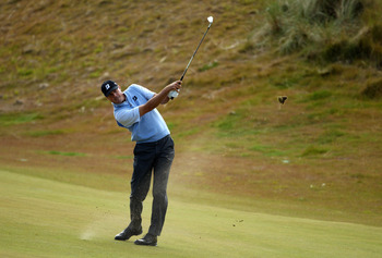 INVERNESS, SCOTLAND - JULY 08:  Matt Kuchar of the USA hits an approach on the 13th hole during the second round of The Barclays Scottish Open at Castle Stuart Golf Links on July 8, 2011 in Inverness, Scotland.  (Photo by Richard Heathcote/Getty Images)