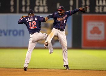 OAKLAND, CA - MAY 18:  Alexi Casilla #12 and Denard Span #2 of the Minnesota Twins celebrate after they beat the Oakland Athletics 4-3 in 10 innings at Oakland-Alameda County Coliseum on May 18, 2011 in Oakland, California.  (Photo by Ezra Shaw/Getty Imag
