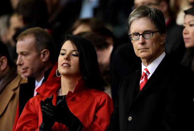 LIVERPOOL, ENGLAND - JANUARY 16:   Linda Pizzuti with her husband and Liverpool owner John W Henry look on prior to the Barclays Premier League match between Liverpool and Everton at Anfield on January 16, 2011 in Liverpool, England. (Photo by Alex Livese