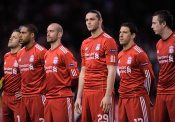 LIVERPOOL, ENGLAND - MARCH 17:  Andy Carroll of Liverpool (C) lines up with his team mates ahead of  the UEFA Europa League Round of 16 second leg match between Liverpool and SC Braga at Anfield on March 17, 2011 in Liverpool, England.  (Photo by Michael