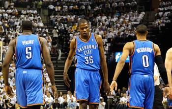 MEMPHIS, TN - MAY 13:  Kevin Durant #35 reacts with Kendrick Perkins #5 and Russell Westbrook #0 of the Oklahoma City Thunder after Perkins' basket and a foul against the Memphis Grizzlies in Game Six of the Western Conference Semifinals in the 2011 NBA P