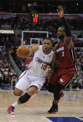LOS ANGELES, CA - JANUARY 12:  Eric Gordon #10 of the Los Angeles Clippers heads to the basket as he is guarded by Dwyane Wade #3 of the Miami Heat at Staples Center on January 12, 2011 in Los Angeles, California.  NOTE TO USER: User expressly acknowledge