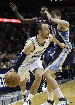 SAN ANTONIO, TX - APRIL 27:  Manu Ginobili #20 of the San Antionio Spurs drives against Marc Gasol #33 of the Memphis Grizzlies in Game Five of the Western Conference Quarterfinals in the 2011 NBA Playoffs on April 27, 2011 at AT&amp;T Center in San Antonio, 