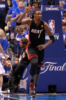 DALLAS, TX - JUNE 09:  Chris Bosh #1 of the Miami Heat reacts as he runs up court against the Dallas Mavericks in Game Five of the 2011 NBA Finals at American Airlines Center on June 9, 2011 in Dallas, Texas.  NOTE TO USER: User expressly acknowledges and