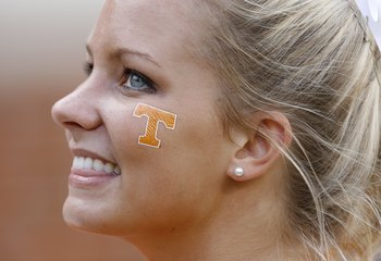 KNOXVILLE, TN - SEPTEMBER 12: A cheerleader of the Tennessee Volunteers smiles from the sideline against the UCLA Bruins on September 12, 2009 at Neyland Stadium in Knoxville, Tennessee. UCLA beat Tennessee 19-15. (Photo by Joe Murphy/Getty Images)