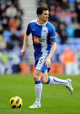 WIGAN, ENGLAND - FEBRUARY 26:  Gary Caldwell of Wigan Athletic in action during the Barclays Premier League match between Wigan Athletic and Manchester United at the DW Stadium on February 26, 2011 in Wigan, England. (Photo by Mike Hewitt/Getty Images)