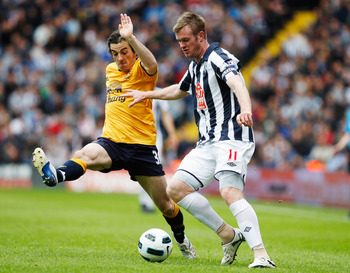 WEST BROMWICH, ENGLAND - MAY 14:  Chris Brunt of West Bromwich Albion tangles with  Leighton Baines of Everton during the Barclays Premier League match between West Bromwich Albion and Everton at The Hawthorns on May 14, 2011 in West Bromwich, England.  (