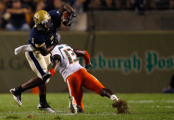 PITTSBURGH - SEPTEMBER 23:  Ray Graham #1 of the Pittsburgh Panthers evades a tackle by Ryan Hill #13 of the Miami Hurricanes on September 23, 2010 at Heinz Field in Pittsburgh, Pennsylvania.  (Photo by Jared Wickerham/Getty Images)