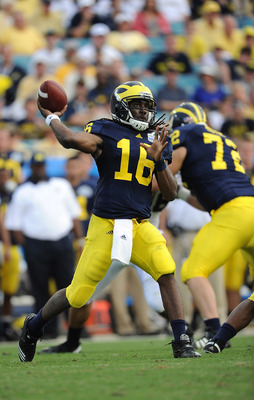 JACKSONVILLE, FL - JANUARY 01:  Quarterback Denard Robinson #16 of the Michigan Wolverines passes against the Mississippi State Bulldogs during the Gator Bowl at EverBank Field on January 1, 2011 in Jacksonville, Florida  (Photo by Rick Dole/Getty Images)