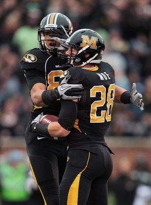 COLUMBIA, MO - NOVEMBER 13:  Michael Egnew #82  of the Missouri Tigers congratulates T.J.Moe #28 with a chest bump after Moe scored a touchdown during the game against the Kansas State Wildcats on November 13, 2010 at Faurot Field/Memorial Stadium in Colu