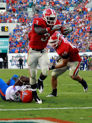 JACKSONVILLE, FL - OCTOBER 30:  Washaun Ealey #3 of the Georgia Bulldogs breaks the tackle of Jelani Jenkins #43 of the Florida Gators during the game at EverBank Field on October 30, 2010 in Jacksonville, Florida.  (Photo by Sam Greenwood/Getty Images)