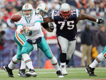 FOXBORO, MA - JANUARY 02:  Chad Henne #7 of the Miami Dolphins pitches the ball as Vince Wilfork #75 of the New England Patriots closes in on January 2, 2011 at Gillette Stadium in Foxboro, Massachusetts.  (Photo by Elsa/Getty Images)