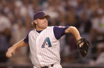 4 Nov 2001: Curt Schilling #38 of the Arizona Diamondbacks delivers in the top of the first inning against the New York Yankees during game seven of the Major League Baseball World Series at Bank One Ballpark in Phoenix, Arizona. The Diamondbacks won 3-2