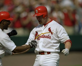 27 Sep 1998:  Mark McGwire #25 of the St. Louis Cardinals is congratulated by teammate Ron Gant #5 after hitting his 70th home run of the season during a game against the Montreal Expos at Busch Stadium in St. Louis, Missouri. The Cardinals defeated the E