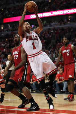CHICAGO, IL - MAY 26:  Derrick Rose #1 of the Chicago Bulls drives for a shot attempt against the Miami Heat in Game Five of the Eastern Conference Finals during the 2011 NBA Playoffs on May 26, 2011 at the United Center in Chicago, Illinois. NOTE TO USER