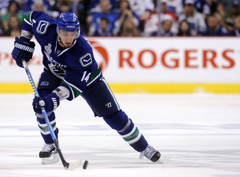 VANCOUVER, BC - JUNE 04:  Alex Burrows #14 of the Vancouver Canucks skates with the puck against the Boston Bruins during Game Two of the 2011 NHL Stanley Cup Final at Rogers Arena on June 4, 2011 in Vancouver, British Columbia, Canada.  (Photo by Harry H