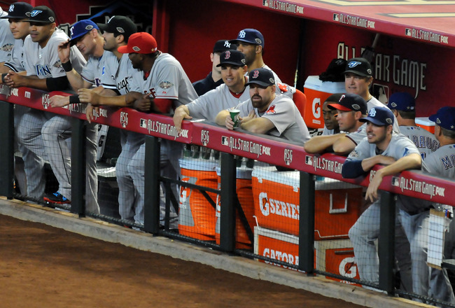 PHOENIX, AZ - JULY 12:  The American League players stands in the dugout during the 82nd MLB All-Star Game at Chase Field on July 12, 2011 in Phoenix, Arizona.  (Photo by Norm Hall/Getty Images)