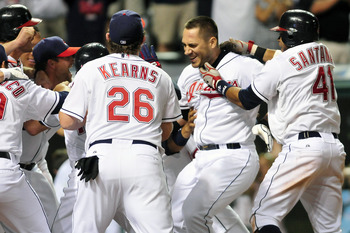 CLEVELAND, OH - JULY 7: Travis Hafner #48 of the Cleveland Indians is greeted by his teammates at home plate after he hit a walk off grand slam home run against the Toronto Blue Jays at Progressive Field on July 7, 2011 in Cleveland, Ohio. The Indians def