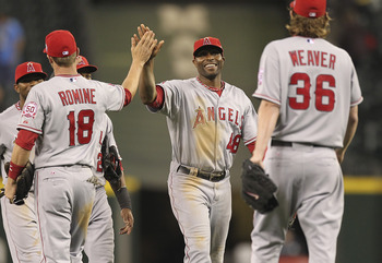 SEATTLE - JUNE 14:  Torii Hunter #48 (C) of the Los Angeles Angels of Anaheim celebrates with Andrew Romine #18 and Jered Weaver #36 after Weaver threw a complete game shutout against the Seattle Mariners at Safeco Field on June 14, 2011 in Seattle, Washi