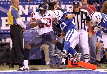 INDIANAPOLIS - NOVEMBER 01:  Andre Johnson #80 of Houston Texans scores a touchdown while defeded by Aaron Francisco #43 of the Indianapolis Colts at Lucas Oil Stadium on November 1, 2010 in Indianapolis, Indiana.  (Photo by Andy Lyons/Getty Images)