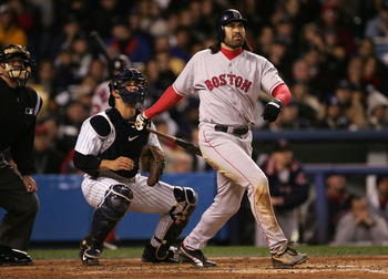 NEW YORK - OCTOBER 20:  Johnny Damon #18 of the Boston Red Sox hits a grand-slam home run in the second inning against the New York Yankees during game seven of the American League Championship Series on October 20, 2004 at Yankee Stadium in the Bronx bor