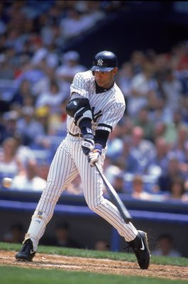2 Aug 2000:  David Justice #28 of the New York Yankees swings low to hit the ball during the game against the Kansas City Royals at Yankee Stadium in the Bronx, New York. The Royals defeated the Yankees 4-1.Mandatory Credit: Al Bello  /Allsport