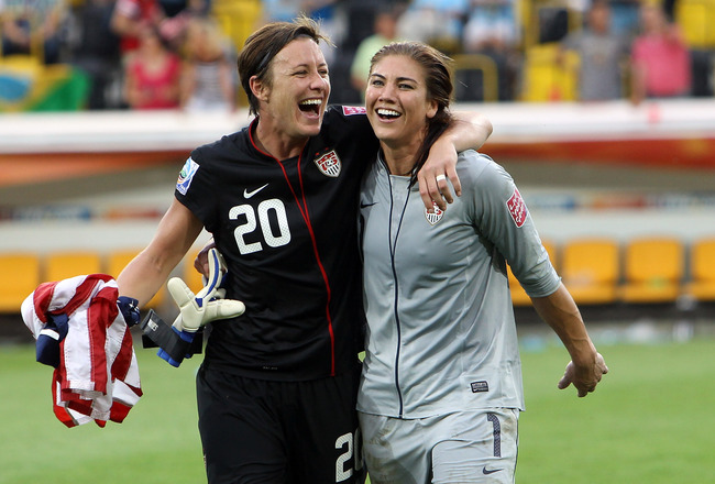 DRESDEN, GERMANY - JULY 10: Abby Wambach (L) and Hope Solo (R), goalkeeper of USA celebrate their victory after penalty shoot out during the FIFA Women's World Cup 2011 Quarter Final match between Brazil and USA at Rudolf-Harbig-Stadion on July 10, 2011 i