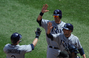MINNEAPOLIS, MN - JULY 6: Sam Fuld #5 and Ben Zobrist #18 of the Tampa Bay Rays congratulate Evan Longoria #3 of the Tampa Bay Rays on a three run home run against the Minnesota Twins in the ninth inning on July 6, 2011 at Target Field in Minneapolis, Min