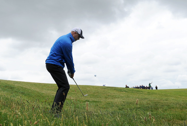 SANDWICH, ENGLAND - JULY 13:  Stewart Cink of the United States hits a shot during the final practice round during The Open Championship at Royal St. George's on July 13, 2011 in Sandwich, England. The 140th Open begins on July 14, 2011.. (Photo by Stuart