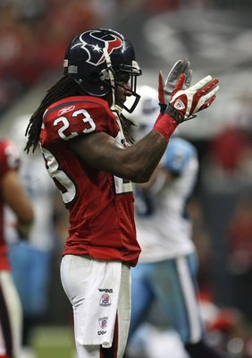 HOUSTON - NOVEMBER 23:  Cornerback Dunta Robinson #23 of the Houston Texans celebrates in the game against the Tennessee Titans on November 23, 2009  at Reliant Stadium in Houston, Texas.  The Titans won 20-17.  (Photo by Stephen Dunn/Getty Images)