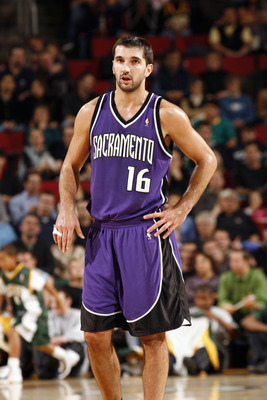SEATTLE - NOVEMBER 20:  Peja Stojakovic #16 of the Sacramento Kings looks on as he waits for play during a game against the Seattle Sonics at the KeyArena on November 20, 2005 in Seattle, Washington. The Sonics won 106-104.  (Photo by Otto Greule Jr/Getty