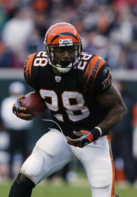 CINCINNATI, OH - OCTOBER 27:  Running Back Corey Dillon #28 of the Cincinnati Bengals advances the ball during the NFL game against the Tennessee Titans at Paul Brown Stadium on October 27, 2002 in Cincinnati, Ohio.  The Titans defeated the Bengals 30-24.