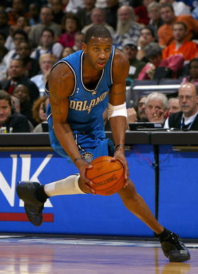 WASHINGTON - DECEMBER 10:  Tracy McGrady #1 of the Orlando Magic grabs a loose ball and heads up court against the Washington Wizards during NBA action December 10, 2003 at the MCI Center in Washington, DC.  NOTE TO USER: User expressly acknowledges and a