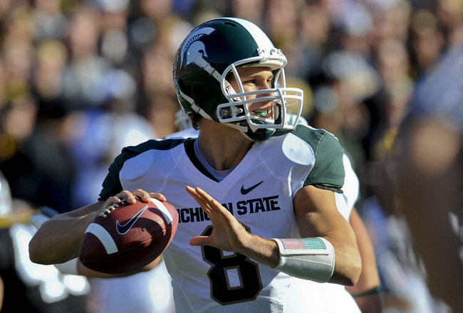 IOWA CITY, IA - OCTOBER 30- Quarterback Kirk Cousins #8 of the Michigan State Spartans looks down field for a receiver during play against the University of Iowa Hawkeyes at Kinnick Stadium on October 30, 2010 in Iowa City, Iowa. Iowa won 37-6 over Michig