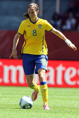 AUGSBURG, GERMANY - JULY 10:  Lotta Schelin of Sweden runs with the ball during the FIFA Women's World Cup 2011 Quarter Final match between Sweden and Australia at the FIFA Women's World Cup Stadium Augsburg on July 10, 2011 in Augsburg, Germany.  (Photo