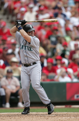 ST. LOUIS - JULY 4:  Edgar Martinez #11 of the Seattle Mariners stands ready at bat during the game against the St. Louis Cardinals on July 4, 2004 at Busch Stadium in St. Louis, Missouri. The Cardinals won 2-1.  (Photo by Dilip Vishwanat/Getty Images)