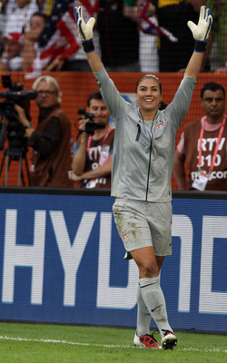 DRESDEN, GERMANY - JULY 10:  Hope Solo, goalkeeper of USA celebrates after she saves a penalty during penalty shoot out during the FIFA Women's World Cup 2011 Quarter Final match between Brazil and USA at Rudolf-Harbig-Stadion on July 10, 2011 in Dresden,