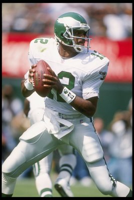 24 Sep 1995:  Quarterback Randall Cunningham #12 of the Philadelphia Eagles fades back to pass against the Oakland Raiders during a game held at the Oakland Coliseum in Oakland, California.  The Raiders won the game, 48-17. Mandatory Credit: Al Bello/Alls
