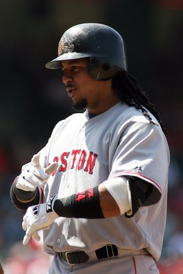 ANAHEIM, CA - JULY 20:  Manny Ramirez #24 of the Boston Red Sox stands on first base against the Los Angeles Angels of Anaheim at Angels Stadium on July 20, 2008 in Anaheim, California.  (Photo by Christian Petersen/Getty Images)
