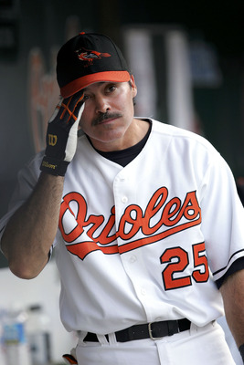 BALTIMORE, MD - AUGUST 29: Rafael Palmiero #25 of the Baltimore Orioles watches from the dugout during the game against the Oakland Athletics on August 29, 2005 at Camden Yards in Baltimore, Maryland.  (Photo By Jamie Squire/Getty Images)