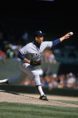 CHICAGO - 1989:  Tommy John #25 of the New York Yankees pitches during a 1989 season game against the White Sox at Comiskey Park in Chicago Illinois.  (Photo by Jonathan Daniel/Getty Images)