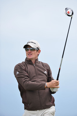SANDWICH, ENGLAND - JULY 13:  Justin Rose of England tees off during the final practice round during The Open Championship at Royal St. George's on July 13, 2011 in Sandwich, England. The 140th Open begins on July 14, 2011..  (Photo by Stuart Franklin/Get