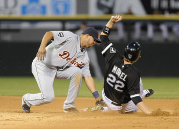 CHICAGO, IL - JUNE 03: Jhonny Peralta # 27 of the Detroit Tigers tags out Brent Morel #22 of the Chicago White Sox at second base on June 3, 2011 at U.S. Cellular Field in Chicago, Illinois.  (Photo by David Banks/Getty Images)