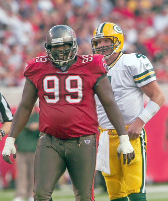 Tampa, FL - NOVEMBER 16:  Warren Sapp #99 of the Tampa Bay Buccaneers laughs with Brett Favre #4 of the Green Bay Packers at Raymond James Stadium, on November 16, 2003, in Tampa, Florida. (Photo by Matt Stroshane / Getty Images)