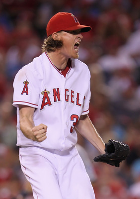ANAHEIM, CA - JULY 07:  Jered Weaver #36 of the Los Angeles Angels of Anaheim celebrates after striking out Carlos Peguero of the Seattle Mariners in the seventh inning at Angel Stadium of Anaheim on July 7, 2011 in Anaheim, California.  (Photo by Jeff Gr