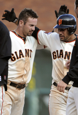 SAN FRANCISCO, CA - APRIL 8: Aaron Rowand #33 (L) of the San Francisco Giants celebrates with Andres Torres #56 after Rowand gets a walk off hit to drive in Torres for the winning run in the Bottom of the 12 inning agains the St. Louis Cardinals to win th